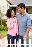 Hispanic couple standing outside new home Stock Photography