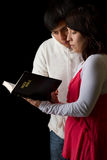 Hispanic Couple Studying the Bible Royalty Free Stock Photography