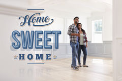Hispanic Couple In Their New Home Sweet Home Royalty Free Stock Photography