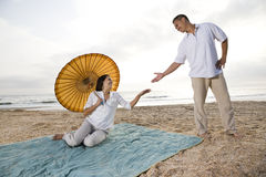 Hispanic couple together on beach Royalty Free Stock Image