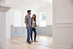 Hispanic Couple Viewing Potential New Home Stock Photos