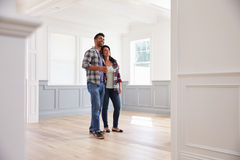 Free Hispanic Couple Viewing Potential New Home Stock Images - 71526364