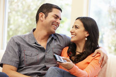 Hispanic couple watching television Stock Photography