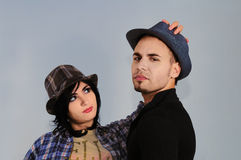 Hispanic couple wearing hats Stock Photos