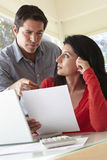 Hispanic Couple Working In  Home Office Royalty Free Stock Photos