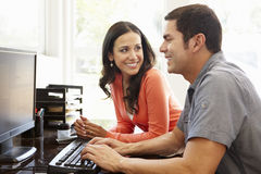 Hispanic couple working in home office Royalty Free Stock Image