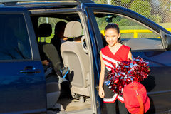 Hispanic Dad Picks Up Daughter After Cheerleader Practice Royalty Free Stock Photo