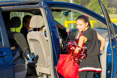 Hispanic Dad Picks Up Daughter After Cheerleader Practice Royalty Free Stock Photos