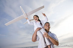 Hispanic dad playing holding girl high on shoulder Royalty Free Stock Image