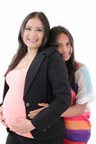 Hispanic Daughter Hugging her businesswoman Pregnant Mother Royalty Free Stock Photography