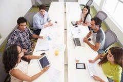 Hispanic Designers Meeting To Discuss New Ideas Stock Photo