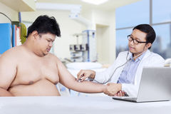 Hispanic doctor examined his patient Stock Photography