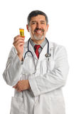 Hispanic Doctor Holding Bottle with Pills Stock Image