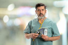 Hispanic doctor holding Social Security Cards and Stethoscope royalty free stock photo