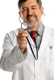 Hispanic Doctor Holding Stethoscope Stock Photography