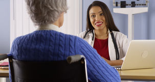 Hispanic doctor sharing good news with patient Stock Photography