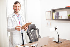 Hispanic doctor welcoming you in his office Stock Photos