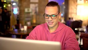 Hispanic Ethnicity Young Man using Laptop Computer at Cozy Coffee Shop. Shot on RED Cinema Camera in 4K UHD stock footage