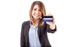 Hispanic executive with a credit card Stock Photo