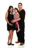 Hispanic Family. With pregnant mother, father and child isolated over white background Royalty Free Stock Images