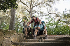 Hispanic family with backpacks hiking in park stock image