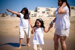 Hispanic Family at the beach. A hispanic family enjoying the waves at the beach stock photos