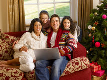 Hispanic family Christmas shopping online Royalty Free Stock Images