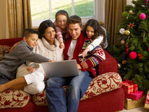 Hispanic family Christmas shopping online. At home royalty free stock image