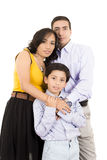 Hispanic family close together holding Royalty Free Stock Image