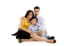 Hispanic family close together holding Royalty Free Stock Photos