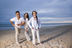 Hispanic family with daughter having fun on beach Stock Photography