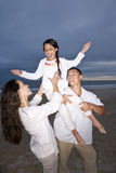 Hispanic family with daughter having fun on beach Royalty Free Stock Photo
