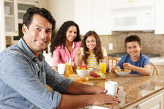 Hispanic family eating breakfast Stock Photography