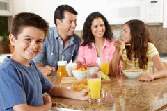Hispanic family eating breakfast. At table Stock Image