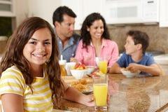 Hispanic family eating breakfast. Girl smiling at camera Stock Image