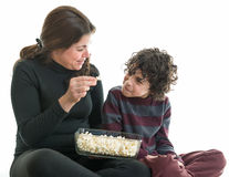 Hispanic Family Eating Popcorn Stock Image