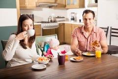 Hispanic family enjoying breakfast at home Stock Photography