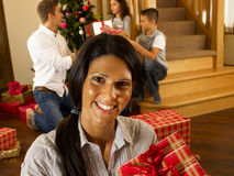 Hispanic family exchanging gifts at Christmas Royalty Free Stock Photos