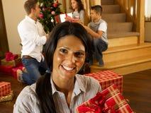 Hispanic family exchanging gifts at Christmas. Smiling Royalty Free Stock Photos