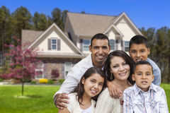 Hispanic Family in Front of Beautiful House Royalty Free Stock Photography
