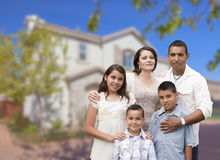 Hispanic Family in Front of Beautiful House. Happy Hispanic Family Portrait in Front of Beautiful House Royalty Free Stock Images