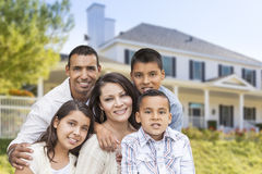 Hispanic Family in Front of Beautiful House Stock Images