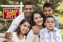 Hispanic Family in Front of Sold Real Estate Sign Royalty Free Stock Photos