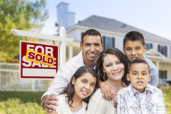 Hispanic Family in Front of Sold Real Estate Sign, House Stock Photography