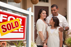 Hispanic Family in Front of Their New Home Stock Photography