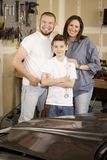 Hispanic Family in Garage Stock Images
