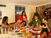 Hispanic family having Christmas dinner. At home stock photos