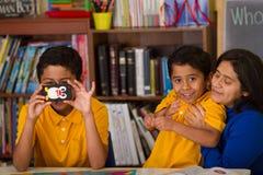 Hispanic Family in Home-School Environment Stock Photo