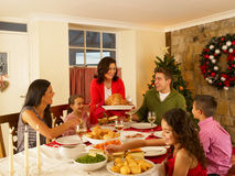 Hispanic family at home serving christmas dinner