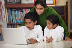 Hispanic Family with Laptop in Home-school Environment Stock Photography